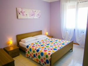 Postel nebo postele na pokoji v ubytování Appartamento Tintoretto