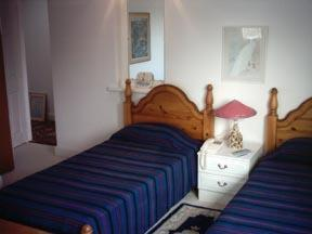 A bed or beds in a room at Waratah Lodge