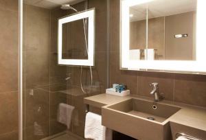 Salle de bains dans l'établissement Novotel Rennes Alma