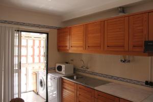 A kitchen or kitchenette at Sesimbra Flat