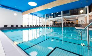 The swimming pool at or near Carat Residenz-Apartmenthaus