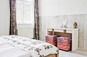 Postel nebo postele na pokoji v ubytování Royal Court Legerova