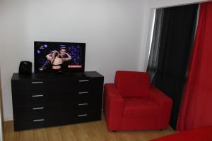 A television and/or entertainment center at Studio Madeira