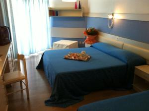 A bed or beds in a room at Hotel Select