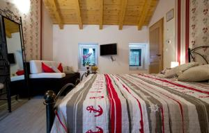 A bed or beds in a room at Villa Ragusa Vecchia