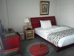 A bed or beds in a room at King Ambassador Hotel Kumagaya