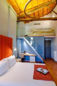 A bed or beds in a room at Splanzia Boutique Hotel