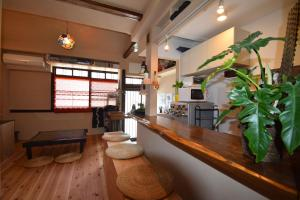 The lobby or reception area at Santana Guest House Kyoto