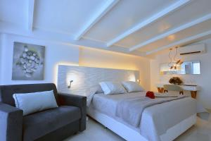 A bed or beds in a room at Corfu Palma Boutique Hotel - Service Excellence