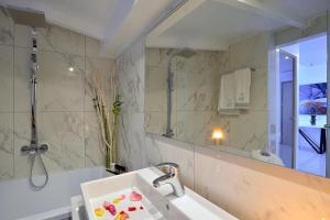 A bathroom at Corfu Palma Boutique Hotel - Service Excellence