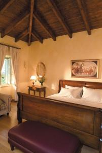 A bed or beds in a room at Hotel Ippoliti