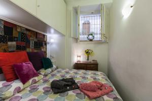 Letto o letti in una camera di Gianicolo Holiday House