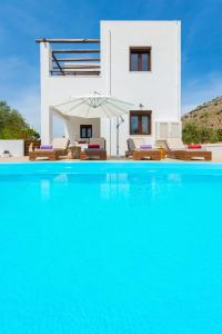 The swimming pool at or near Melfe Villas