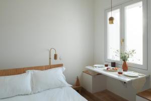 Uma cama ou camas num quarto em Casa Modesta