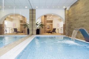 The swimming pool at or near Mercure Brides Les Bains Grand Hôtel des Thermes