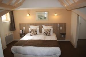 Cama o camas de una habitación en La Vieille Auberge