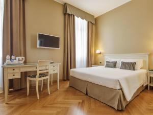 Кровать или кровати в номере Hotel Continentale