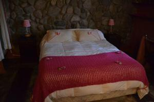 A bed or beds in a room at Rincon del Valle