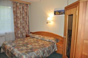 Кровать или кровати в номере Гостиница Западная