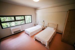 Letto o letti in una camera di Oasi Hostel