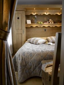 A bed or beds in a room at CGH Résidences & Spas Les Clarines