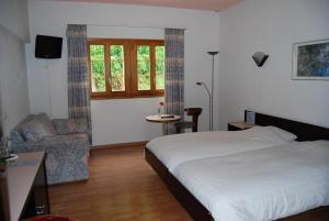 Un ou plusieurs lits dans un hébergement de l'établissement Hotel du Pigne