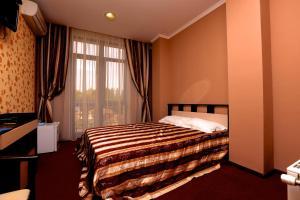 Кровать или кровати в номере Hotel Palanga