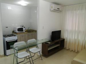 A kitchen or kitchenette at Apartment Cabo Branco #4