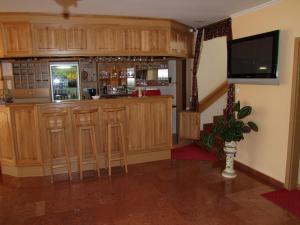 The lounge or bar area at Júlia Panzió
