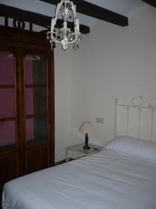 Cama o camas de una habitación en Apartamentos Turísticos Rincón de la Magdalena