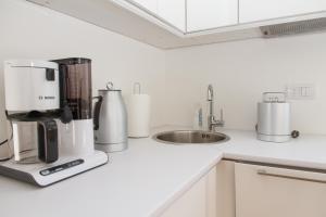 Kuhinja ili čajna kuhinja u objektu Apartment Slavia District