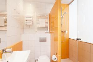 Een badkamer bij Libertel Gare de L'Est Francais