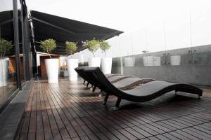 Der Swimmingpool an oder in der Nähe von NM Lima Hotel