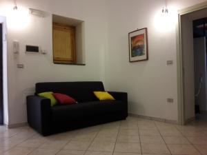 A seating area at Palazzo Storico Gatto