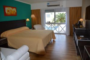 A bed or beds in a room at Alto Verde Suite & Apart