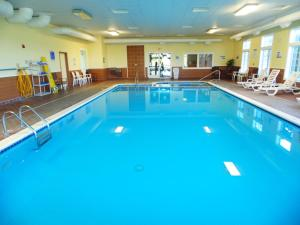 The swimming pool at or near American Inn and Suites Houghton Lake