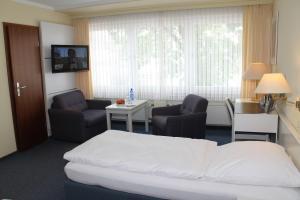 Ein Sitzbereich in der Unterkunft Hotel Wirth