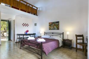 A bed or beds in a room at Rodi Studios