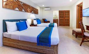 A bed or beds in a room at Bluewater Maribago Beach Resort
