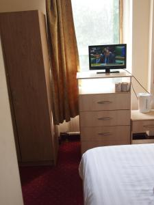 A television and/or entertainment center at Hotel Olympia