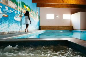 The swimming pool at or near Hotel De Normandie