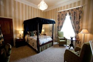 A bed or beds in a room at Ringwood Hall Hotel & Spa