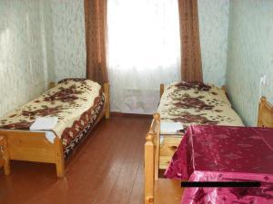Кровать или кровати в номере Гостевой дом Андреевщина