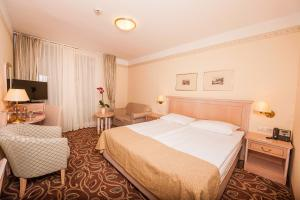 Кровать или кровати в номере Grand Hotel Sava Superior