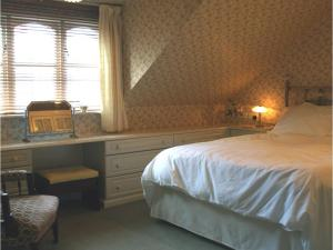 A bed or beds in a room at The Mulberry House
