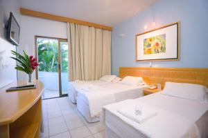 A bed or beds in a room at Wetiga Hotel