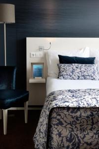 Un ou plusieurs lits dans un hébergement de l'établissement Hotel Zeerust Texel
