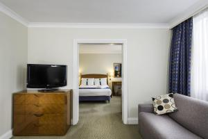 A television and/or entertainment center at Holiday Inn - Glasgow Airport, an IHG Hotel
