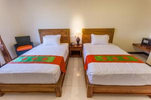 A bed or beds in a room at Mahatma Residence