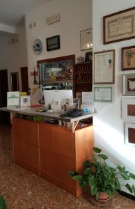 The lobby or reception area at Albergo Adriana